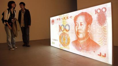 "Visitors look at the art work by American artist Tony Oursler entitled ""100 Yuan (People's Republic of China)"" which features a projection of a Chinese renminbi note with a talking Mao Zedong at a gallery in Beijing, China, Thursday, April 8, 2010. U.S. Treasury Secretary Timothy Geithner is expected to press Beijing over its currency controls when he meets a Chinese vice premier in a sign the two sides are stepping up efforts to narrow their differences in the dispute. (AP Photo/Ng Han Guan)"