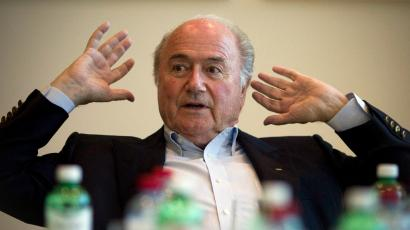 FIFA President Sepp Blatter gestures during an interview at the FIFA headquarters in Zurich, Switzerland, Thursday, May 19, 2011. FIFA President Sepp Blatter says a whistleblower from Qatar's 2022 World Cup bid will be interviewed over allegations that bribes were paid to African voters. The whistleblower claims that FIFA executive committee members Issa Hayatou and Jacques Anouma were paid $1.5 million to vote for Qatar.