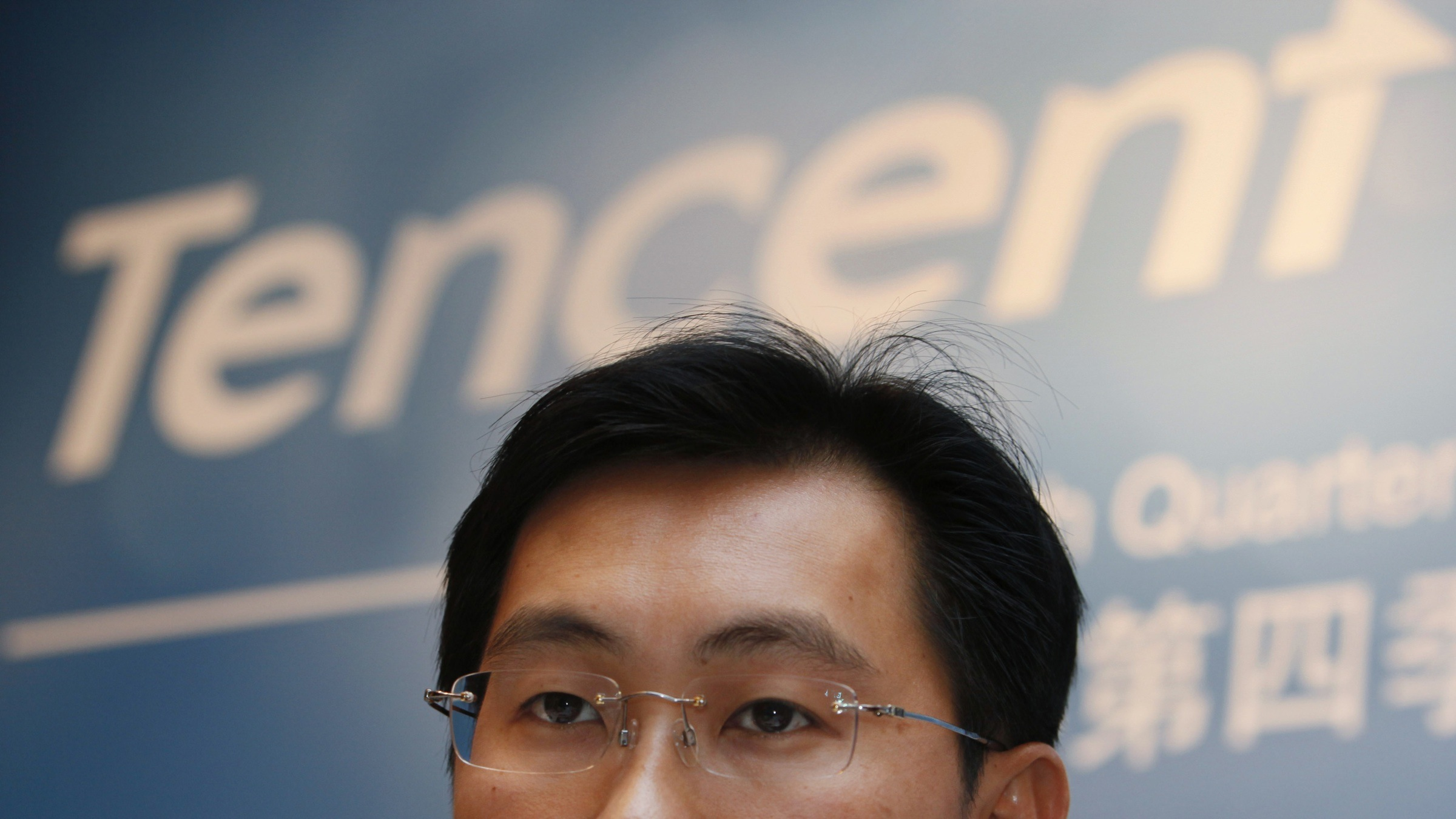Pony Ma, Chairman and CEO of Tencent Holdings Limited speaks during the news conference for the 2009 fourth quarter and annual company result announcement in Hong Kong Wednesday, March. 17, 2010. Tencent Holdings Limited, a leading provider of Internet and mobile & telecommunications value-added services in China, announces their profit for the year was RMB5,221.6 million (US$764.7 million), an increase of 85.4% year of year.  (AP Photo/Kin Cheung)