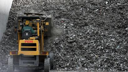 In this May 31, 2005 file photo, a Chinese worker collects aluminum for recycling at a smelting plant in the outskirts of Shanghai, China. Aluminum Corp. of China, the world's biggest aluminum producer, agreed Thursday Feb. 12, 2009, to invest $19.5 billion in global miner Rio Tinto Group, the country's biggest overseas investment so far.