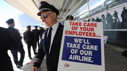 American Airlines pilots march in protest outside a terminal at Dallas-Fort Worth International Airport in Grapevine, Texas, Wednesday, Oct. 31, 2012.