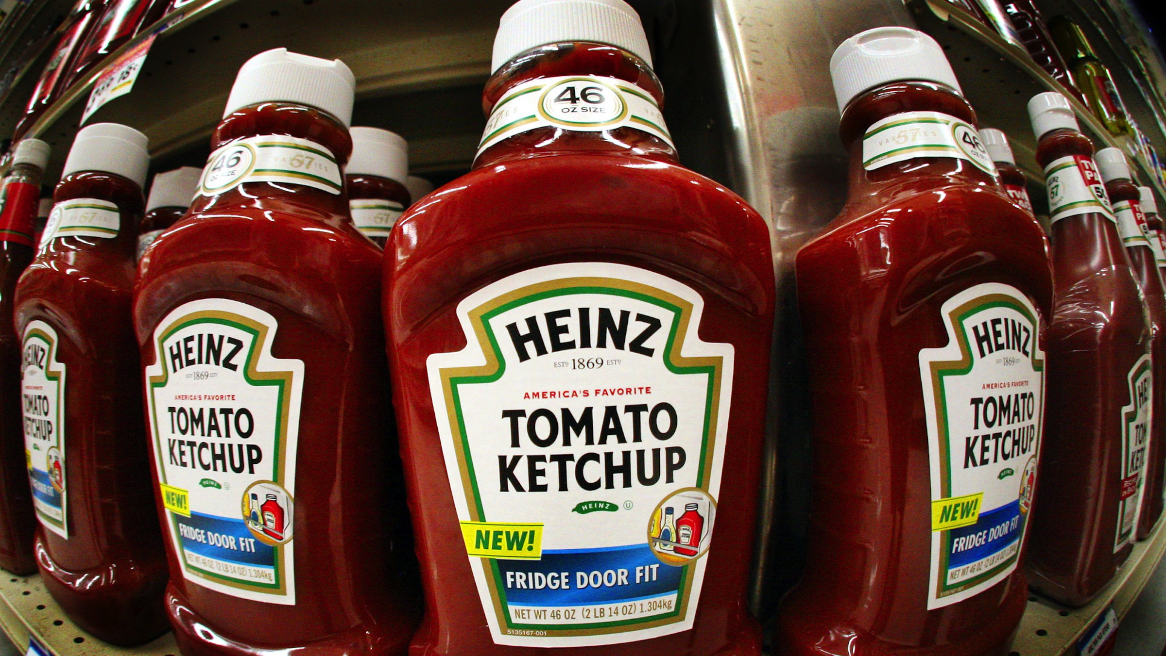 FILE - In this file photo taken, Aug. 31, 2006, using a fisheye lens, bottles of Heinz ketchup line the shelves of a West Mifflin, Pa., market. Food maker H.J. Heinz said Thursday, May 27, 2010, rising sales in emerging markets pushed its fourth-quarter net income up 9.7 percent.(AP Photo/Gene J. Puskar, file)