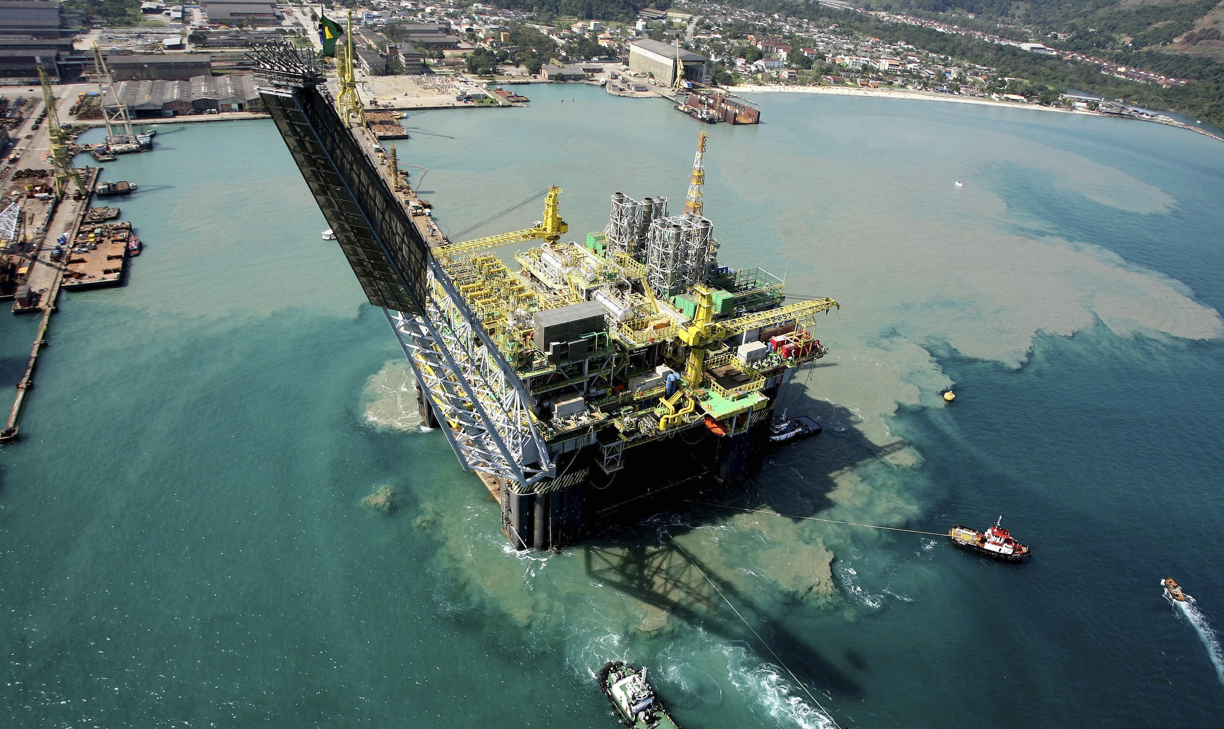 This photo released by Petrobras shows an aerial view of an oil platform in Rio de Janeiro, in this 2007 photo. Booming Brazil is in overdrive with test drilling at a potentially mammoth offshore oil field, trucks jamming ports to offload soy shipments for China, biofuel production galore and plenty of cash for mega-infrastructure projects ranging from bridges to dams.(AP Photo/Petrobras)