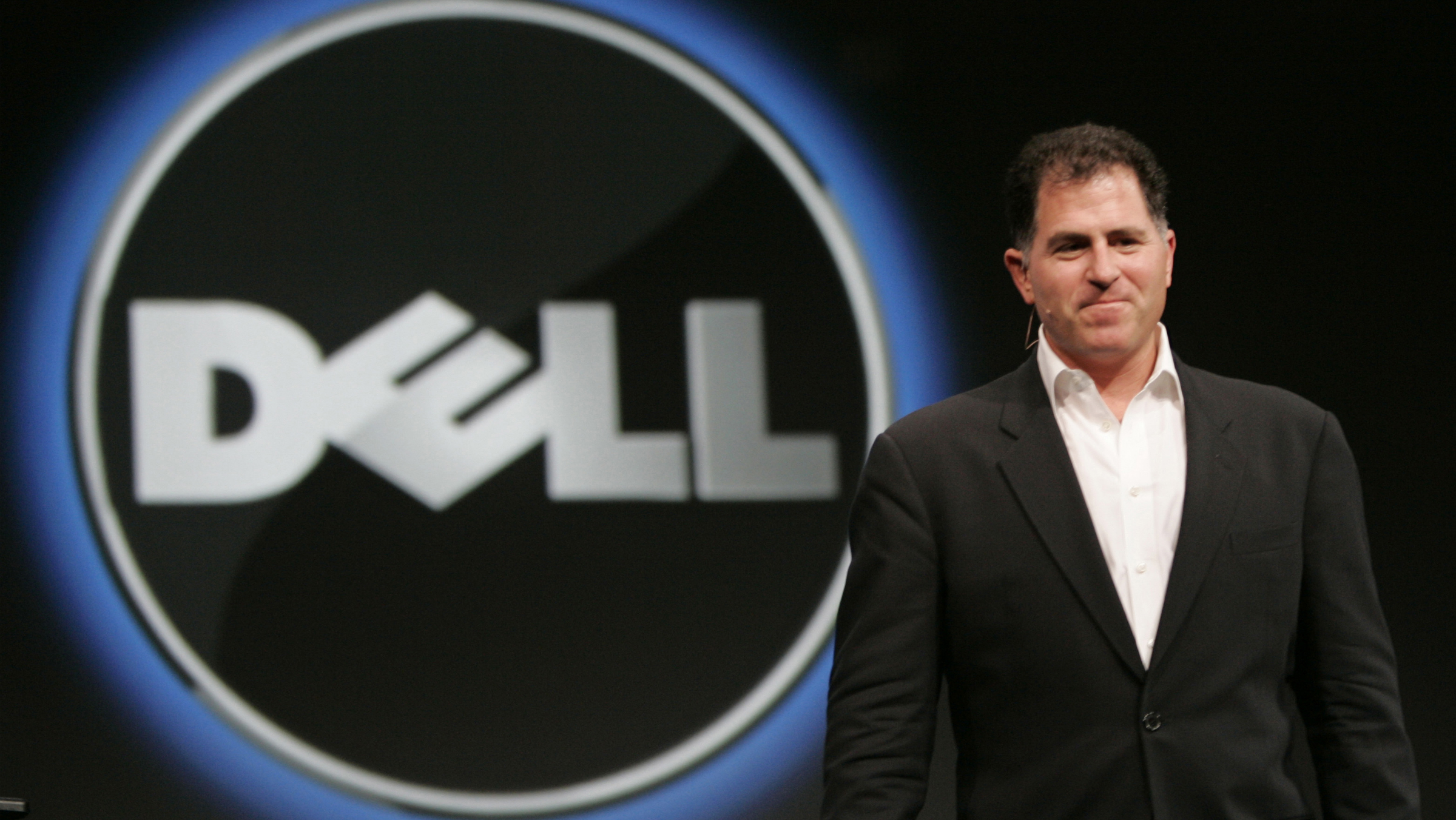 Dell CEO Michael Dell smiles at Oracle Open World conference in San Francisco in this Nov. 14, 2007 file photo. Dell Inc. is reviving plans to buy back shares in the company and will begin to repurchase $10 billion in common stock this week, Dell said Tuesday, Dec. 4, 2007. (AP Photo/Paul Sakuma, file)