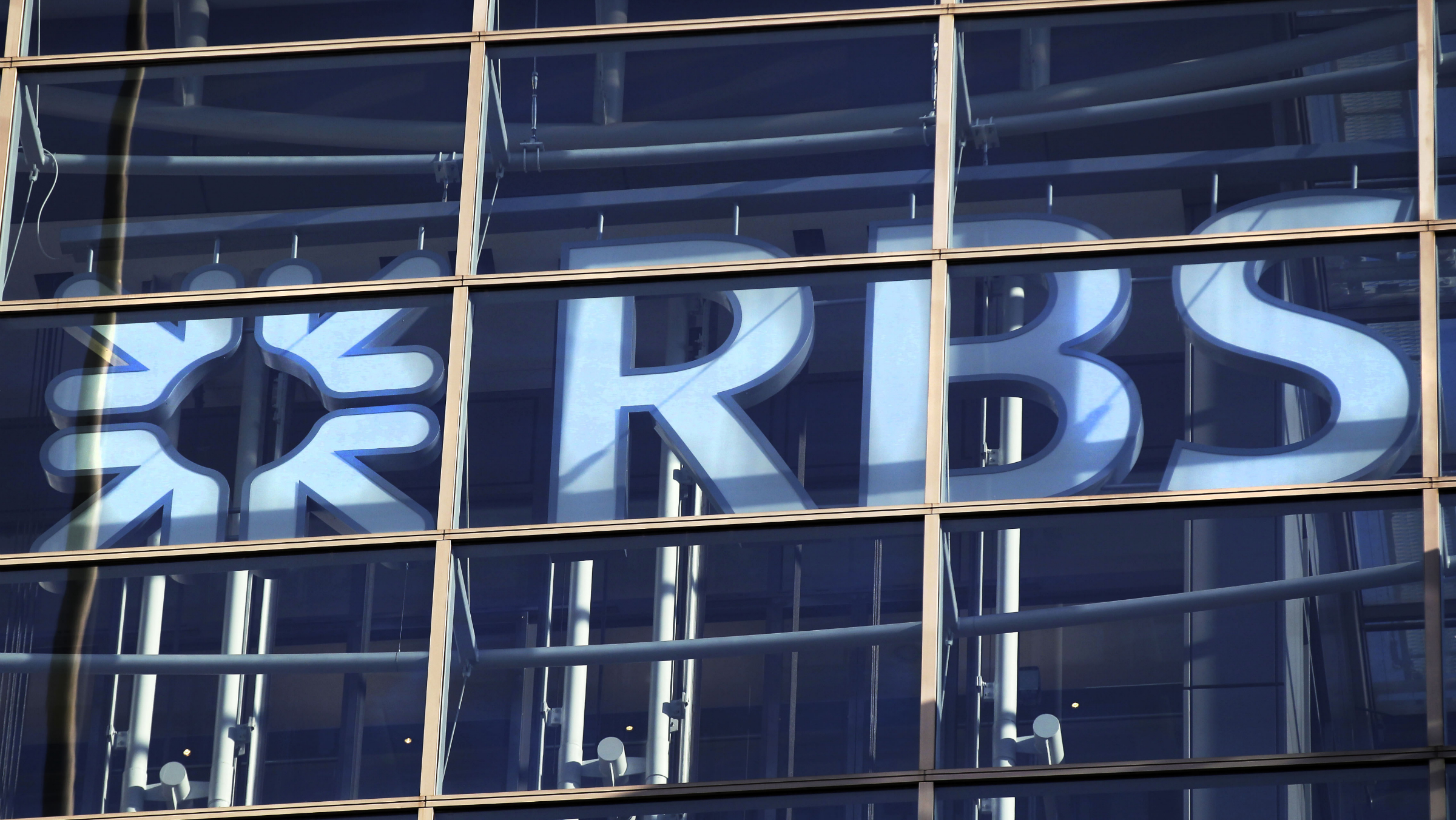 A sign of RBS, RoyalBankofScotland, is seen at its office in the City of London, Friday, Jan. 27, 2012. RBS bank's board of directors have awarded the bank's CEO Stephen Hester 3.6 million shares for his work over the last year, worth about 963,000 pounds ($1.5 million) based on Thursday's closing share price, although 82 percent of the bank is owned by the British government after recent financial bailouts. (AP Photo/Sang Tan)