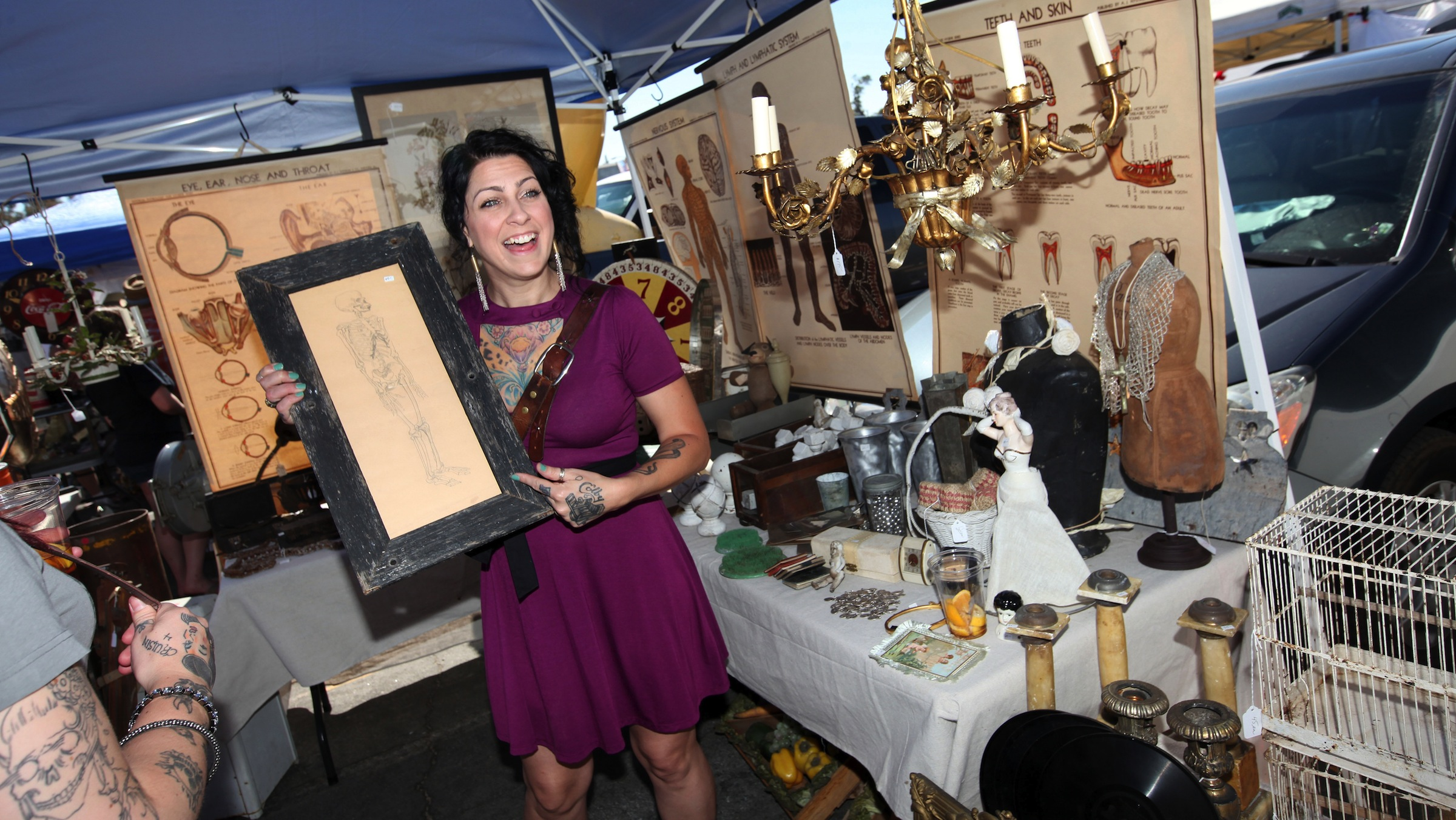 "COMMERCIAL IMAGE - Danielle Colby from American Pickers on HISTORY® with her ""pick of the day"" at the Rose Bowl Flea Market on Sunday, July 8, 2012 in Pasadena, Calif. (Photo by Casey Rodgers/Invision for History/AP Images)"