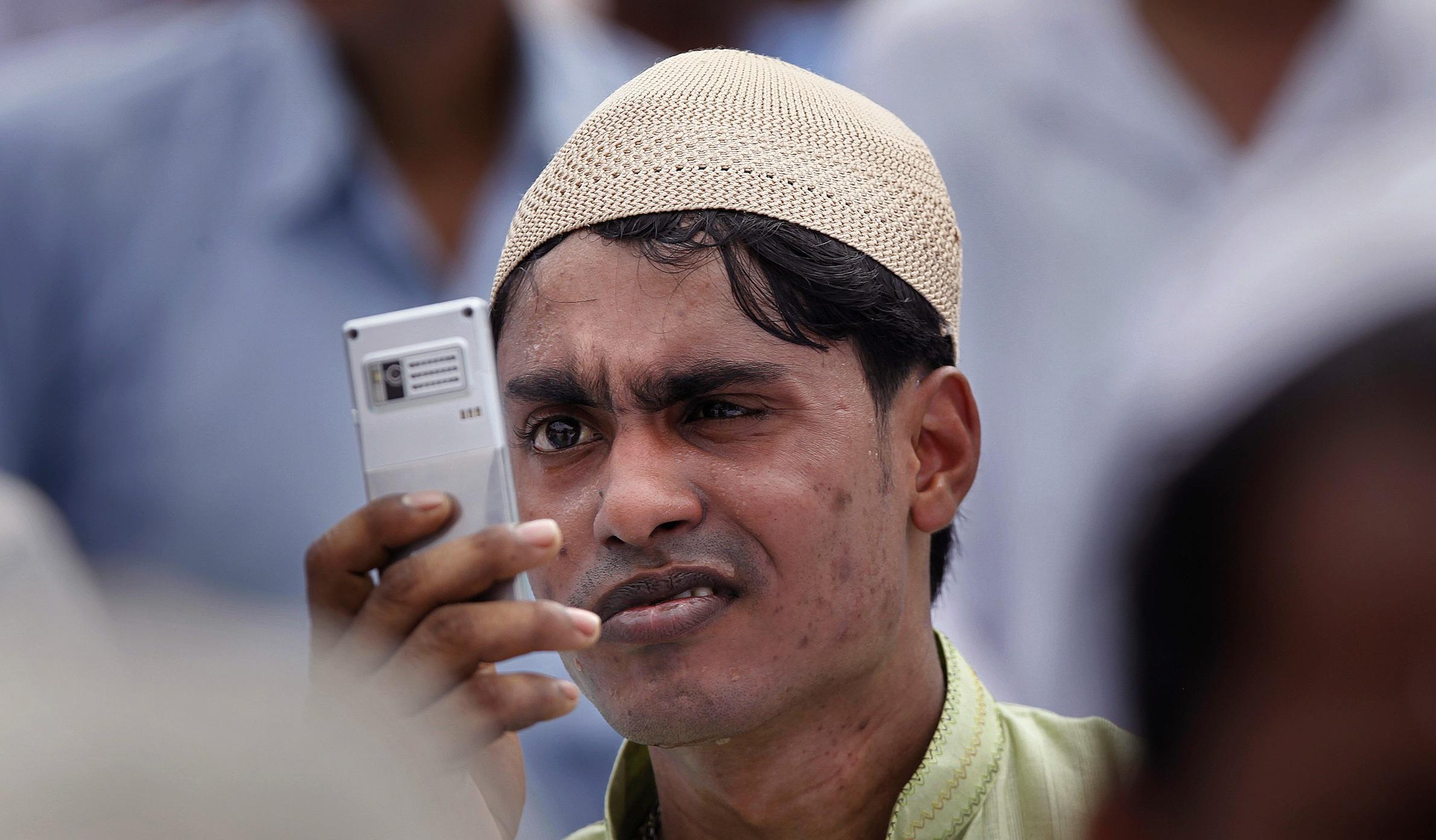 Indian man on phone