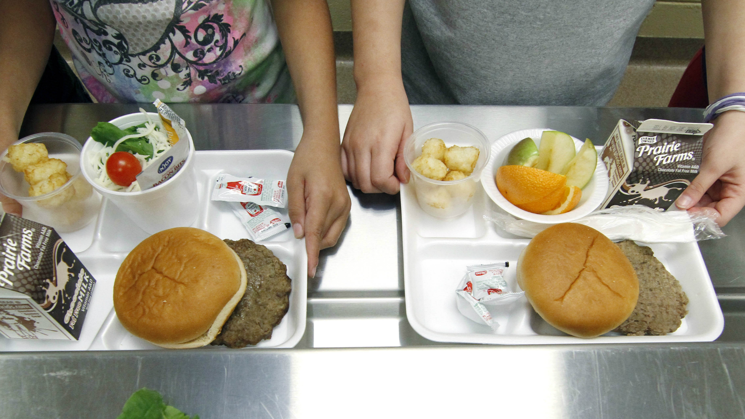 School children are offered a nutritious menu that includes burgers and tater tots