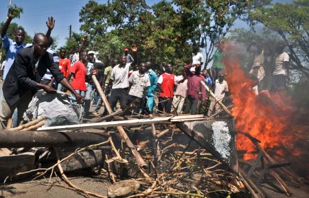 Demonstrators set up burning tyre roadblocks to protest the results of the Orange Democratic Movement (ODM) primary elections, in the town of Ahero near Kisumu in western Kenya Sunday, Jan. 20, 2013.