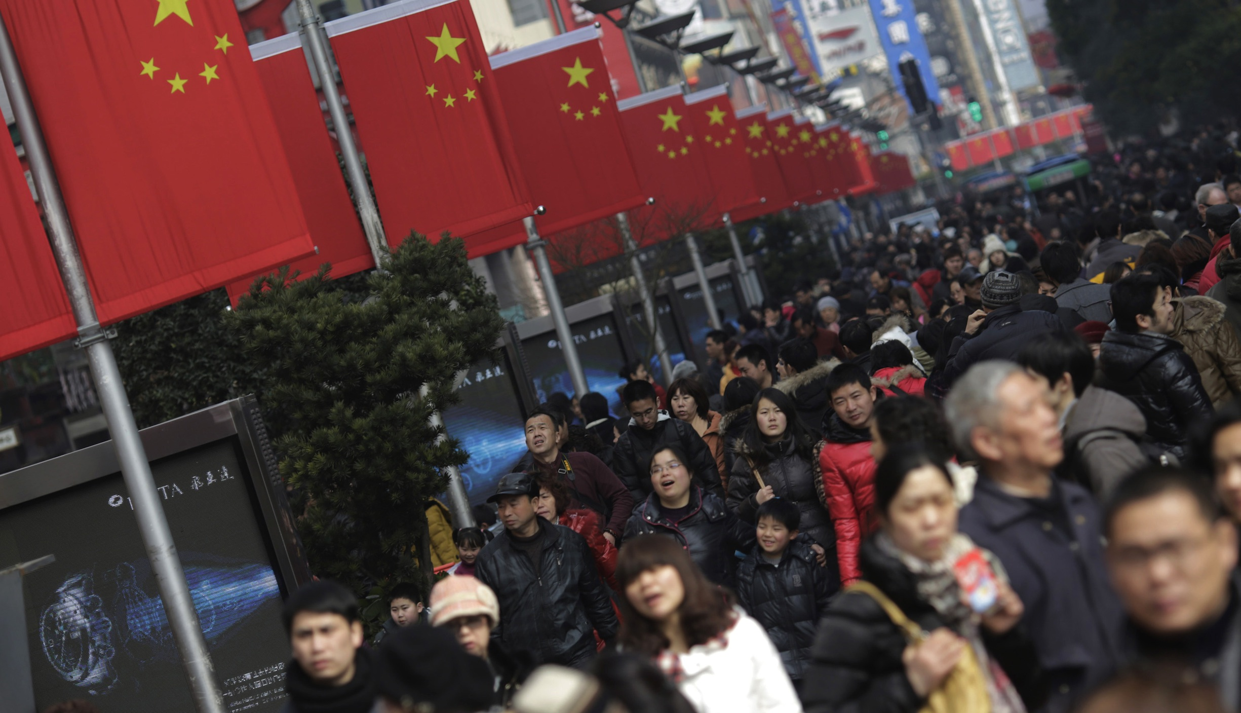 Visitors crowd a shopping street in Shanghai, China on Wednesday Feb. 13, 2013, on the fourth day of the Chinese Lunar New Year. Chinese celebrate the arrival of the Year of the Snake, according to the Chinese Zodiac.