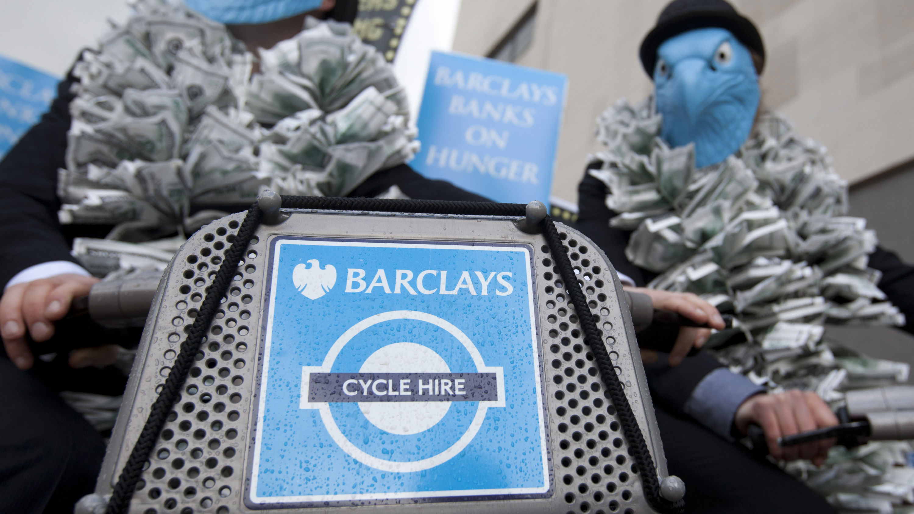 Demonstrators protesting about Barclays Bank and its world wide operations outside the Royal Festival Hall where the Barclays Bank Annual General Meeting for shareholders is being held in London, Friday, April 27, 2012. The protesters wear blue eagle masks which is the Barclay Bank company logo. Barclays PLC reported a 25 percent gain in first-quarter net profit on Thursday, beating market forecasts with strong performances in its retail and business banking, and wealth and investment management divisions. For the three months ending March 31, Barclays reported an adjusted profit after tax of 1.87 billion pounds ($3 billion) after taxes, compared to 1.5 billion pounds a year earlier. Income rose by 5 percent to 8.14 billion pounds.