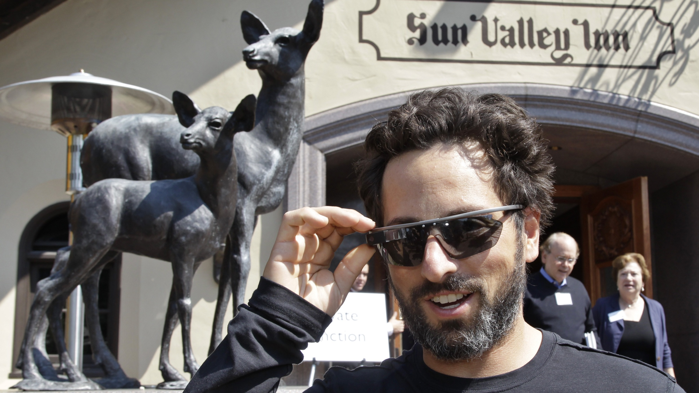 """Google co-founder Sergey Brin demonstrates his """"Google Glasses"""" at the Allen & Company Sun Valley Conference in Sun Valley, Idaho, Thursday, July 12, 2012. (AP Photo/Paul Sakuma)"""