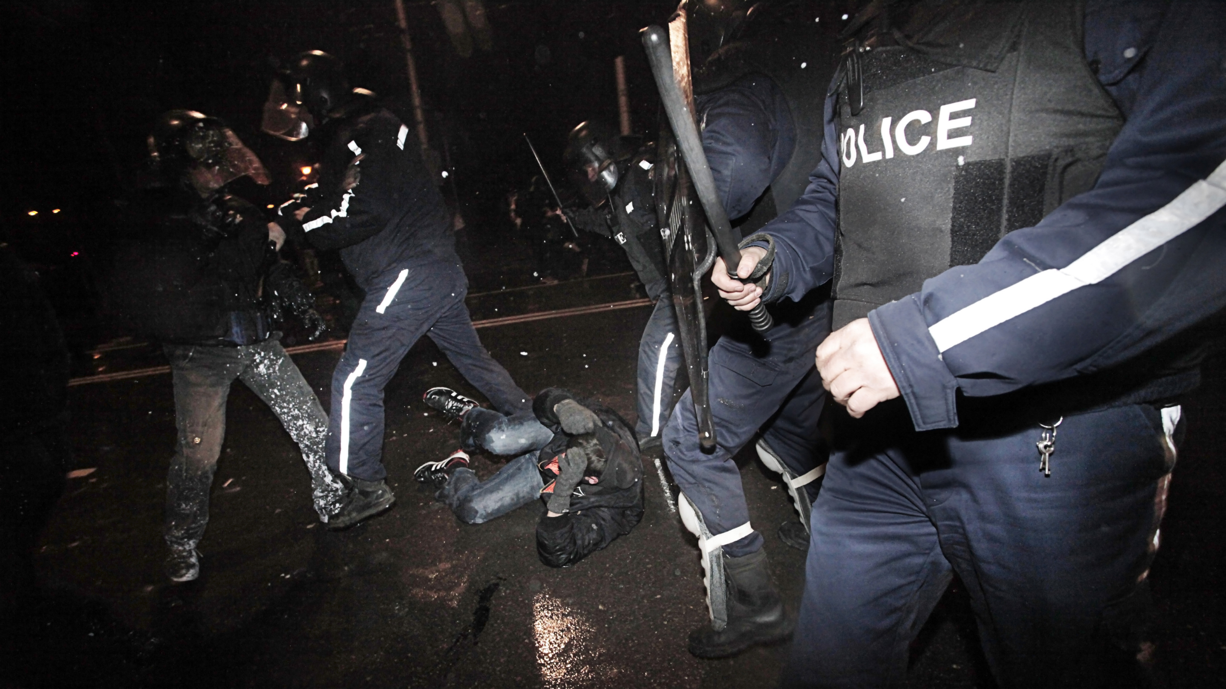 Protesters are beaten and detained by the riot police during a protest against high electricity prices in Sofia, on late Tuesday, Feb. 19, 2013. Bulgaria's prime minister announced on Tuesday that the license held by a Czech company for power distribution in parts of the Balkan country will be revoked following protests against high electricity prices.