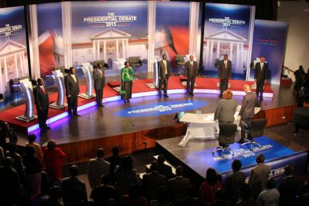 The eight Kenyan presidential candidates stand during the second of the presidential debates held at Brook House School Nairobi Monday, Feb. 25, 2013.