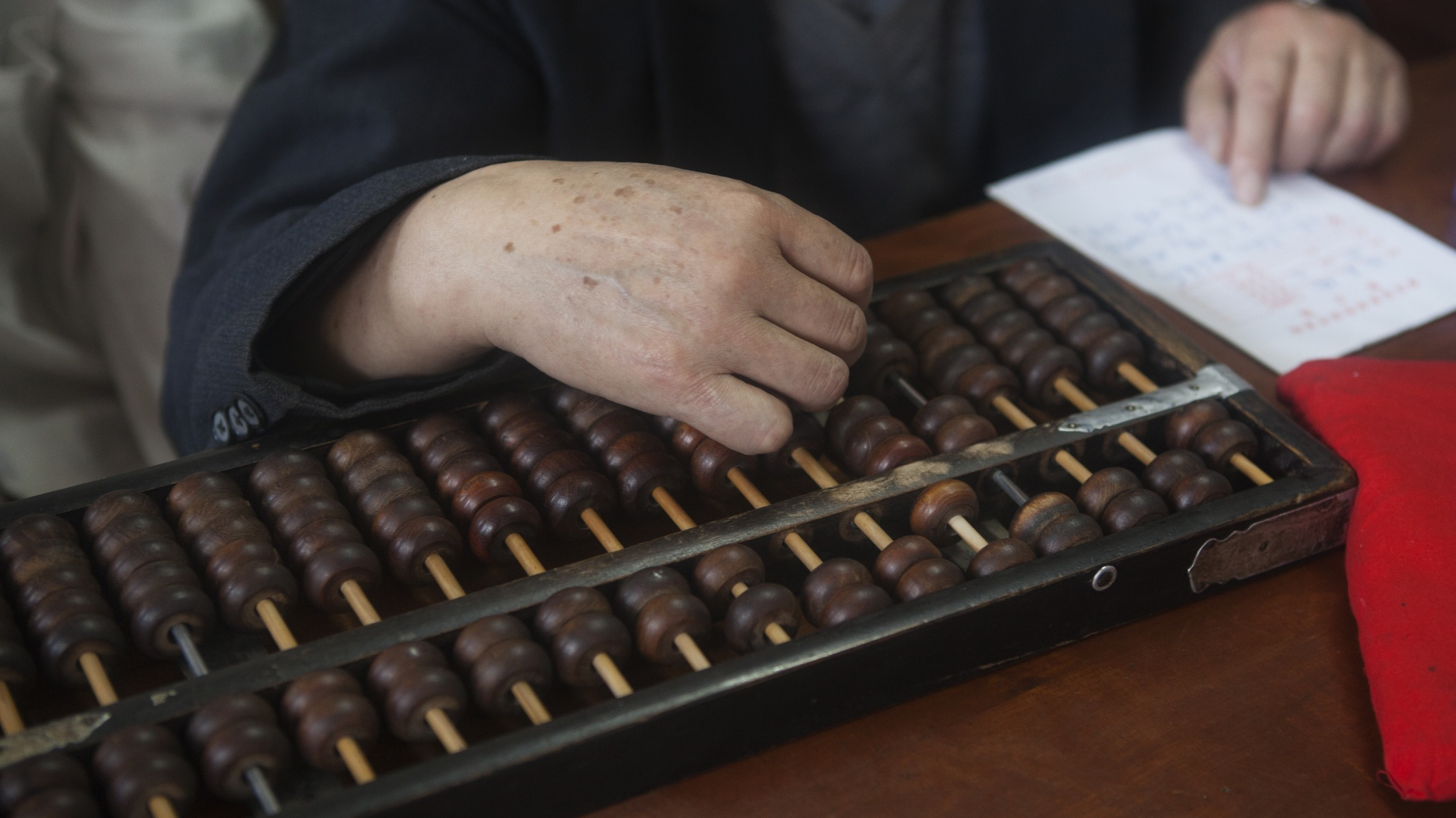 Man working with an abacus