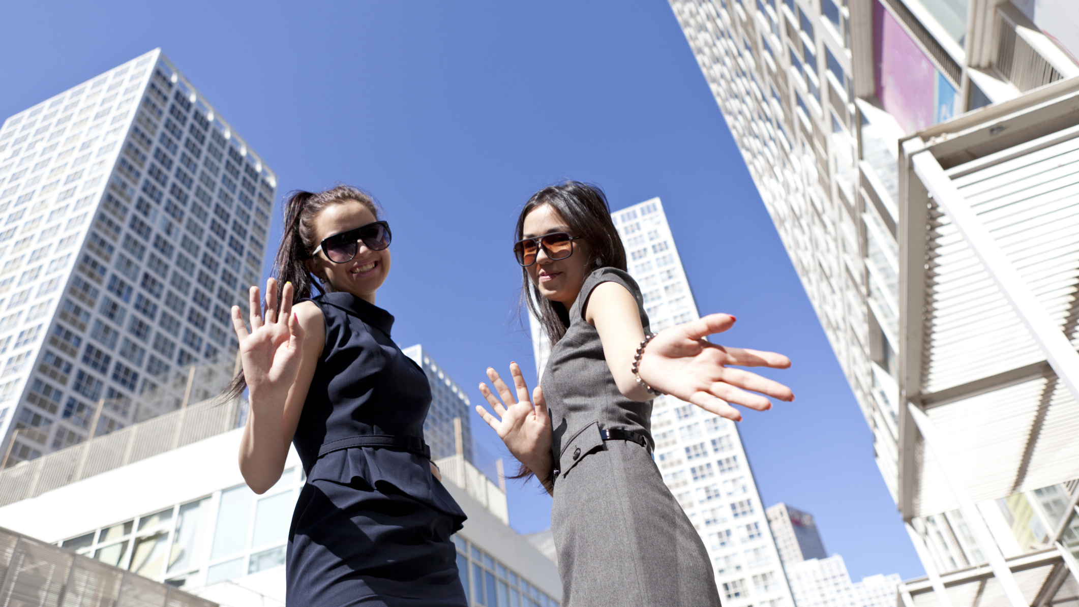People, Well-dressed, Confidence, Happiness, Carefree, City, Success, Business, Horizontal, Waist Up, Outdoors, 20-24 Years, Sunglasses, Low Angle View, China, Caucasian Ethnicity, Smiling, Waving, Day, Beijing, Global Business, Skyscraper, Adult, Young Adult, Color Image, Downtown District, City Life, Two People, Only Young Women, Only Women, Businesswoman, Photography, Tourism, Real People, Capital Cities, Clear Sky, Adults Only, Beautiful People, Beautiful Woman, Corporate Business, Y120810.