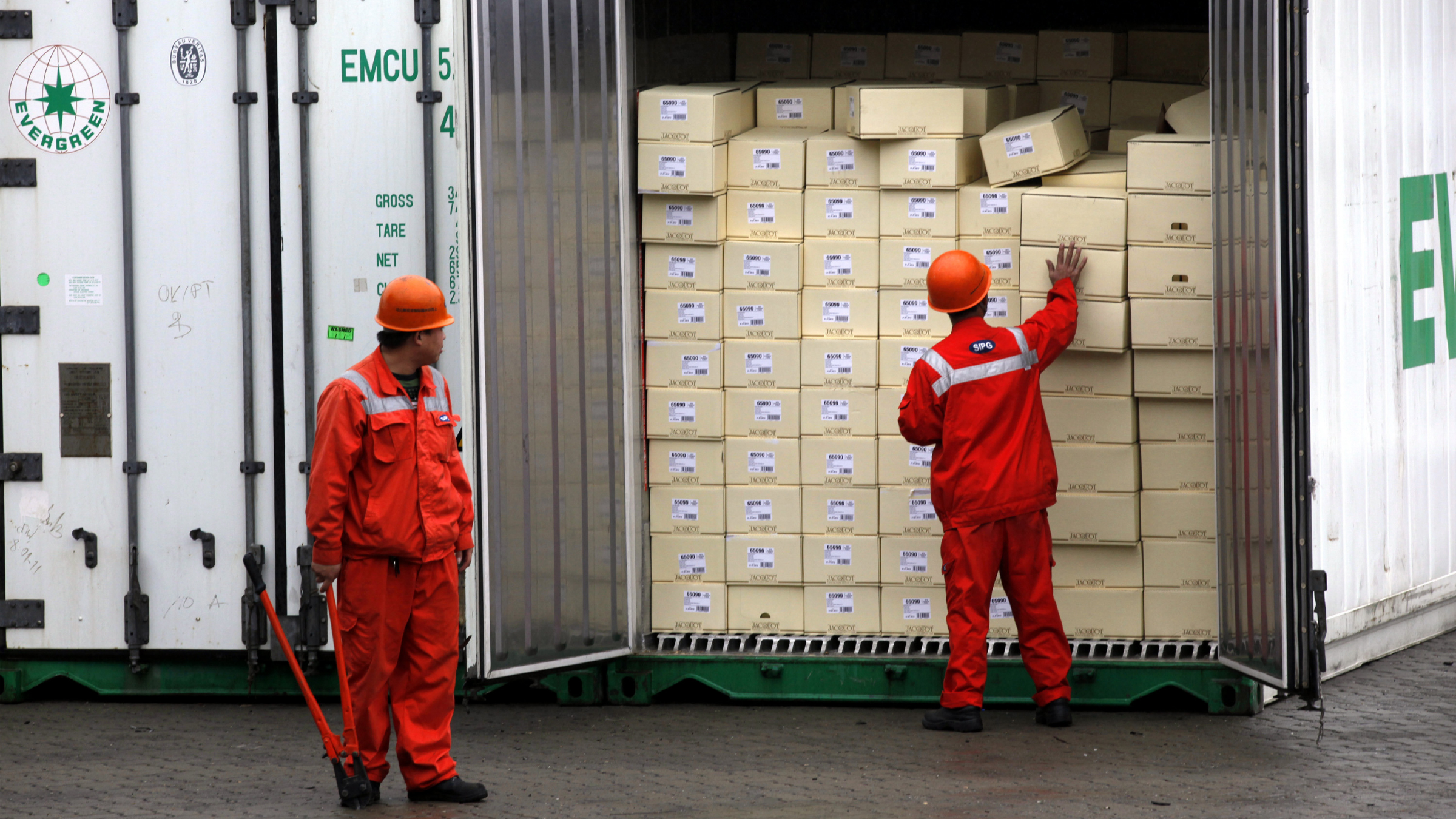 In this Wednesday, Dec. 7, 2011 file photo, custom officers check a container at the Yangshan Port in Shanghai, China. China says its trade rebounded in February after a Lunar New Year slowdown but a broader measure gave clear signs both global and Chinese demand are weakening. Customs data Saturday, March 10, 2012 showed exports grew 18.4 percent over a year earlier, up from January's 0.5 percent contraction. Imports jumped 39.6 percent, up from the previous month's decline of 15 percent.