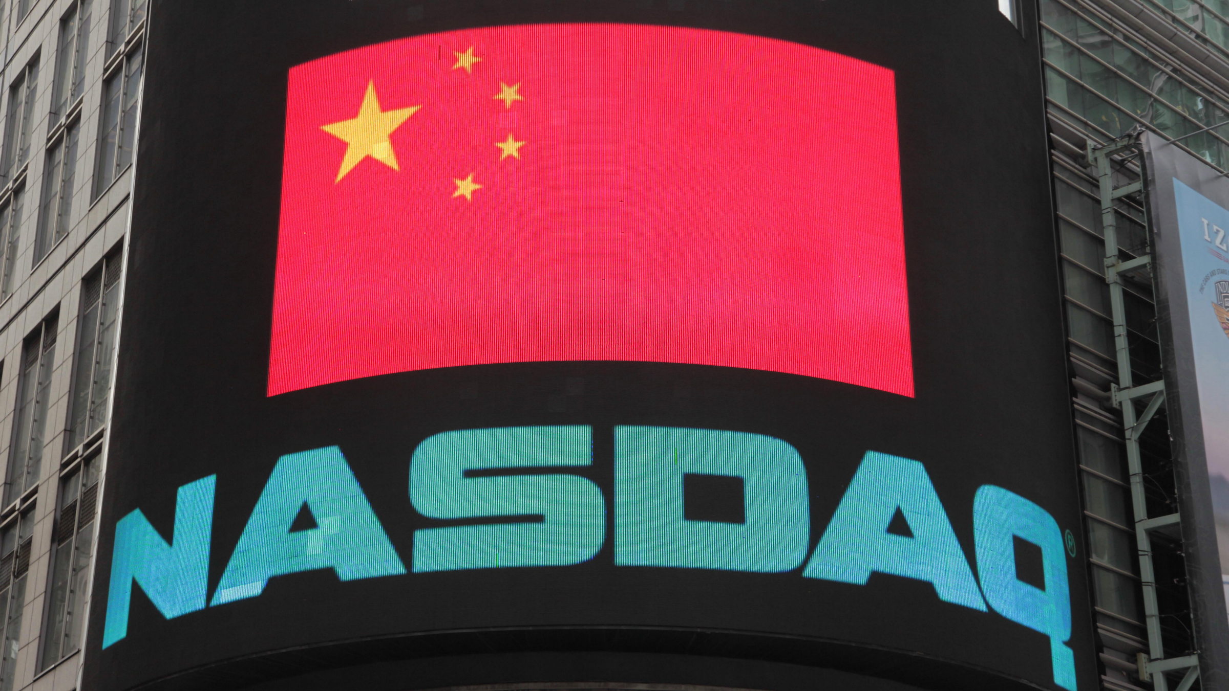 The Chinese flag is displayed on an electronic screen at Nasdaq, Wednesday, May 11, 2011 in New York. Jiayuan.com, China's largest dating website, failed to price in its IPO at Nasdaq.