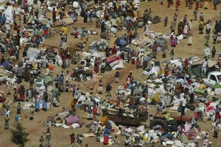 Displaced people with their belongings gather in the town of Burnt Forest, some 35 kilometers from Eldoret, Kenya, Friday, Jan. 4, 2008.