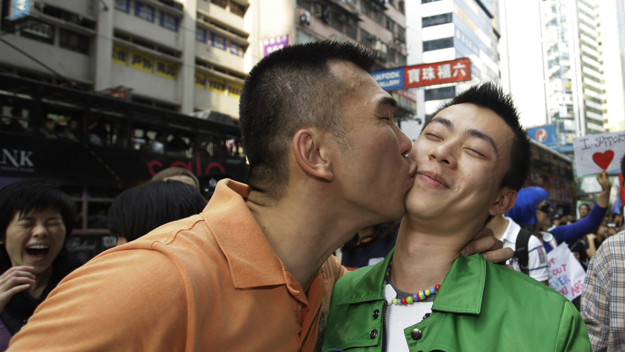 Gay participants, Wesley Poon, left, kisses his friend Tim Lee of Hong Kong during a gay rally in Hong Kong Saturday, Dec. 13, 2008. Hundreds of gay supporters, from various lesbian, gay and bisexual transgender communities marched as fighting for their rights.