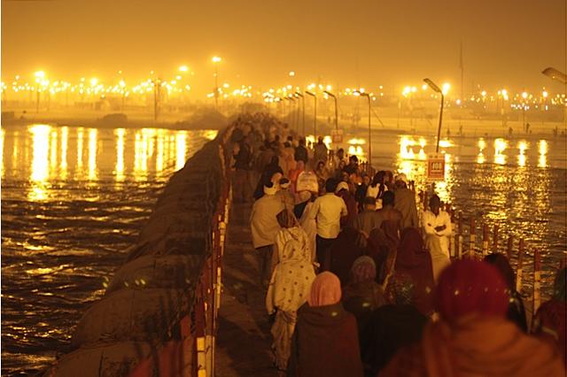 Pilgrims stream across one of many pontoon bridges spanning the Ganga river.