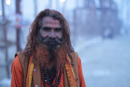 A holy man with henna-dyed beard has just had a dip in the Ganga on February 6.