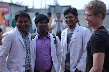 Medical students from nearby Alahabad speak with Aaron Heerboth (R), one of the Harvard team coordinators from the FXB Center for Health and Human Rights.