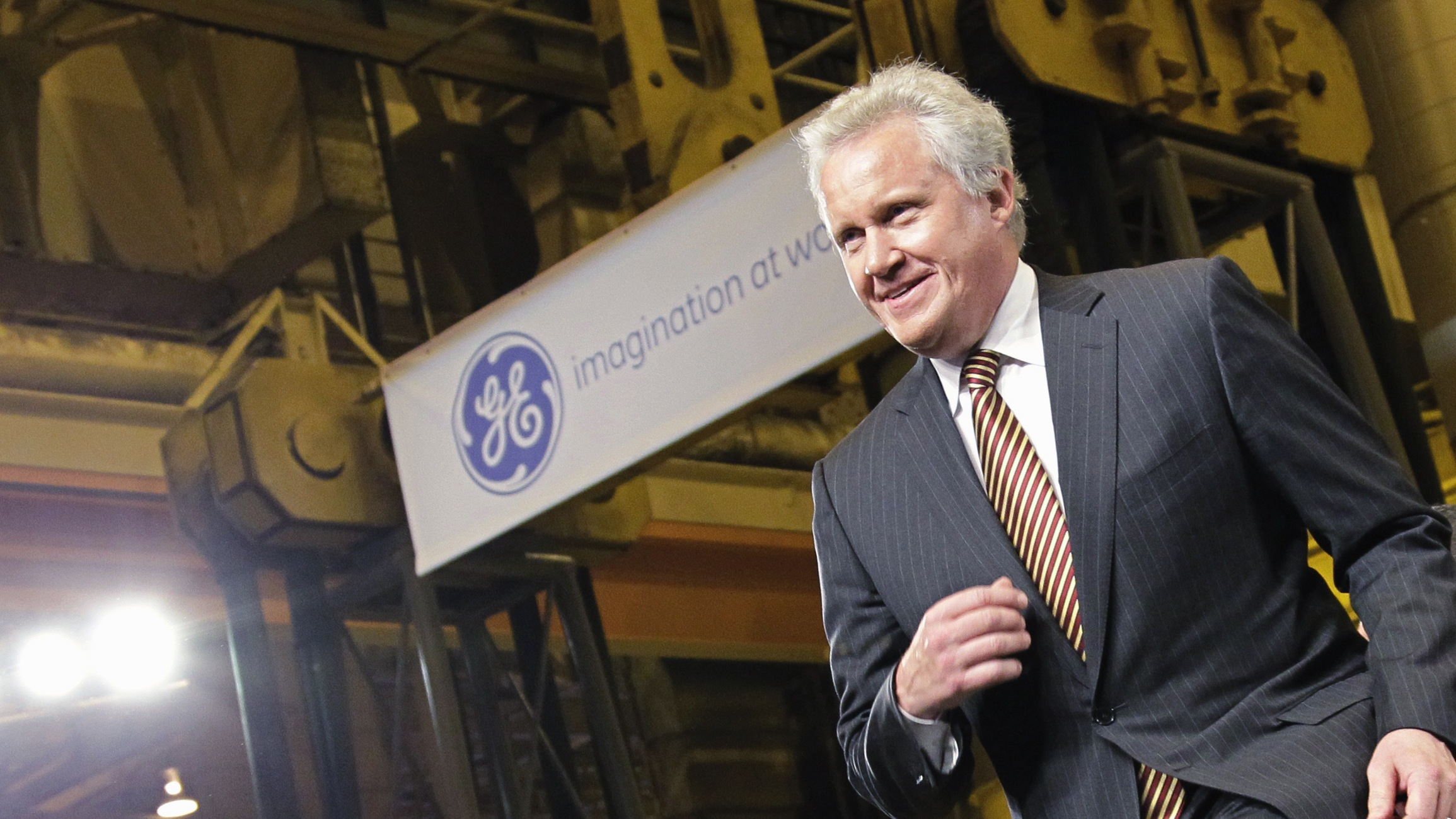 GE CEO Jeffrey Immelt strides to the stage at the GE plant in Schenectady, NY, to introduce President Barack Obama, Friday, Jan. 21, 2011. Obama just announced a restructured presidential advisory board to be led by Immelt that focuses on increasing employment and competitiveness. (AP Photo/J. Scott Applewhite)