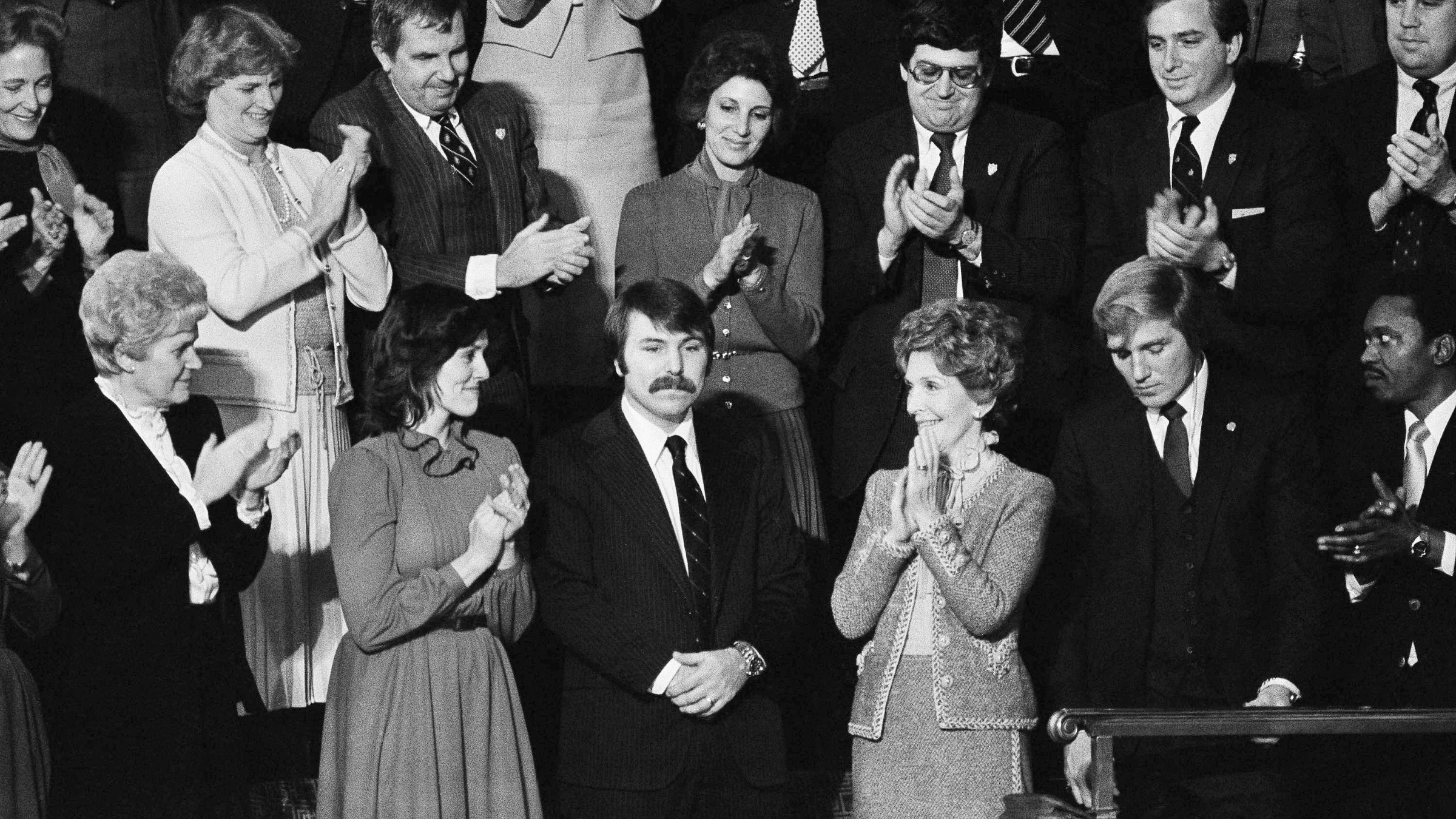 Lennie Skutnik the man who jumped into the Potomac River and saved one of the passengers aboard the Air Florida jetliner that crashed there on January 13 receives applause from first lady Nancy Reagan and his wife at night on Tuesday, Jan. 27, 1982 at House chamber of Capitol Hall in Washington.