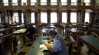 A man studying in a public library.