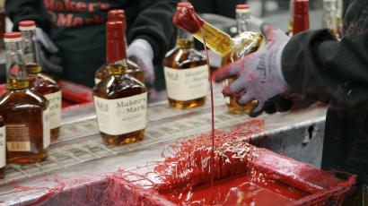 Maker's Mark bottle being sealed with red wax