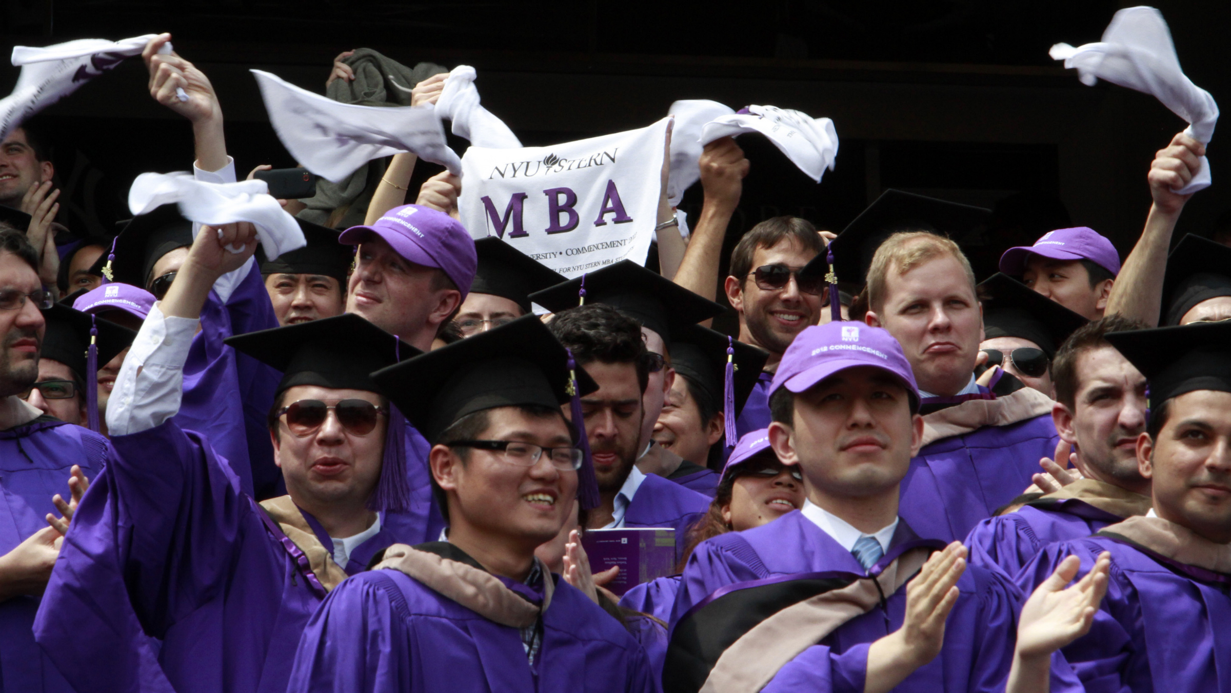 "Graduates from the Leonard N. Stern School of Business cheer and wave ""MBA"" towels as they are declared degree candidates, during the New York University 180th commencement ceremony at Yankee Stadium on Wednesday, May 16, 2012 in New York."