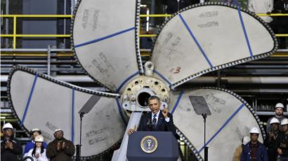 Standing in front of a ships propeller, President Barack Obama, gestures during a speech about automatic defense budget cuts, Tuesday, Feb. 26, 2013, at Newport News Shipbuilding in Newport News, Va.