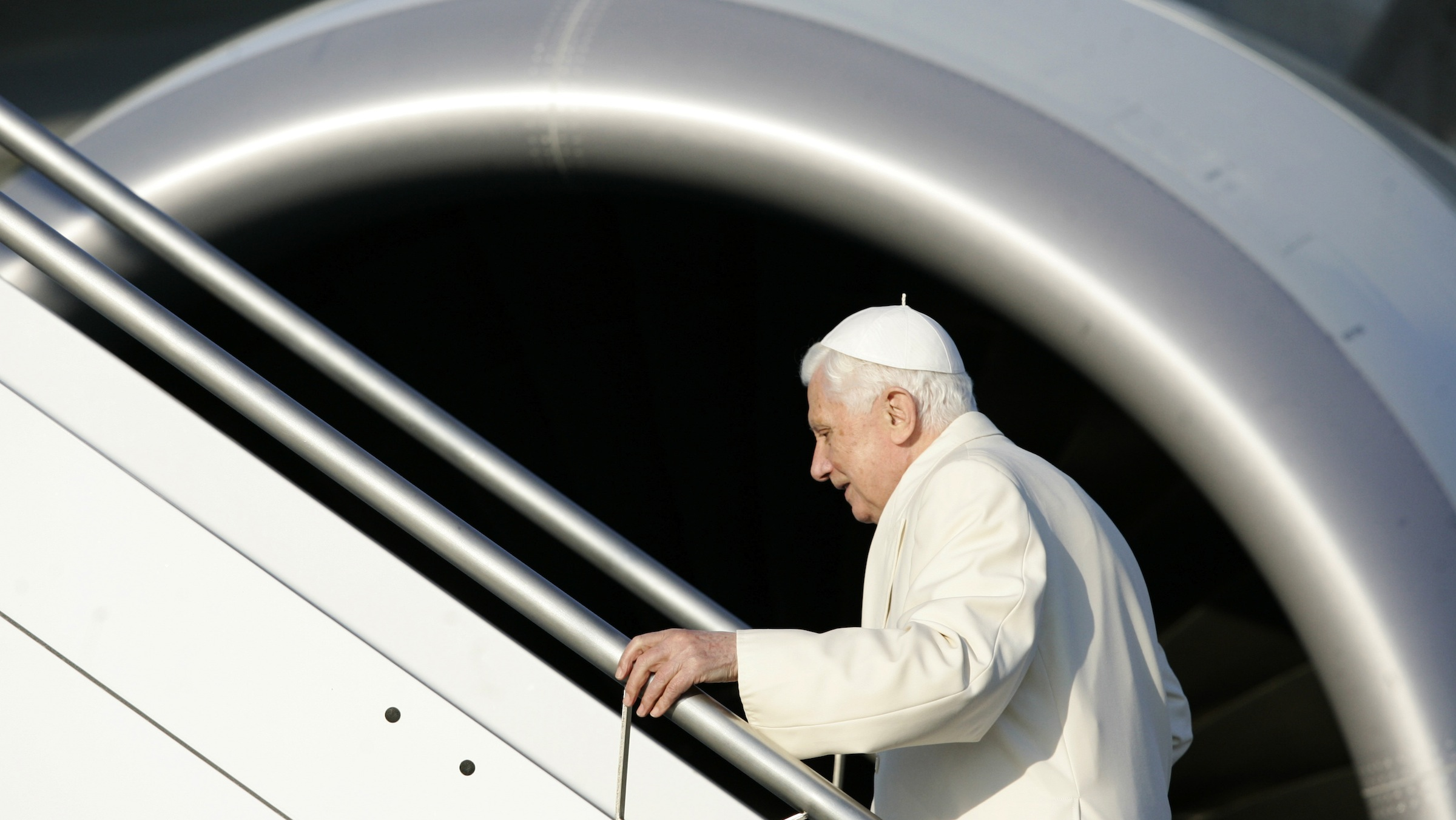 Pope Benedict XVI boards a plane