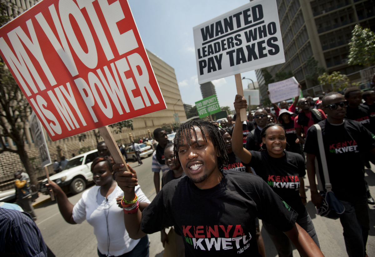 Kenyans demonstrate against their members of Parliament who quietly awarded themselves a $110,000 bonus for five years of service in parliament, near the parliament building in downtown Nairobi, Kenya Tuesday, Oct. 9, 2012.