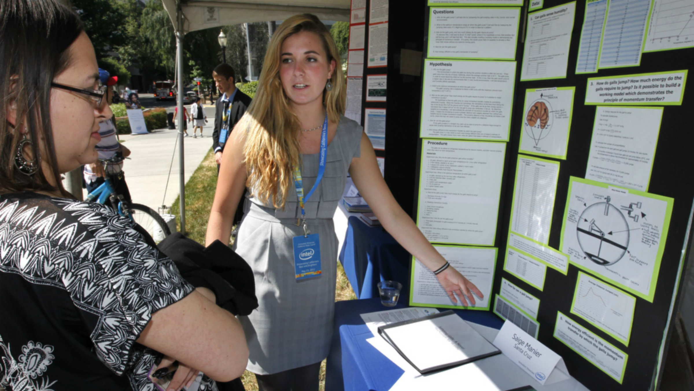 A young scientist explaining a research project.