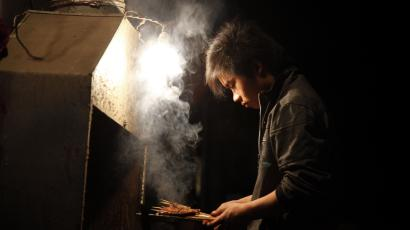 A street vendor prepares sticks of barbecued meat in Beijing early Friday, May 20, 2011. (AP Photo/Ng Han Guan)