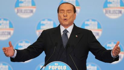 Pucker up! Berlusconi looks to plant a kiss on the Italian electorate.