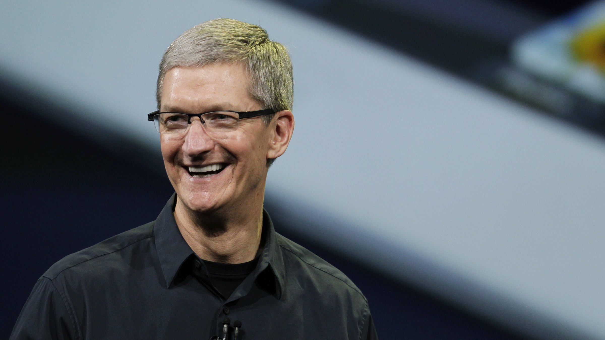 In this Wednesday, March 7, 2012 photo, Apple CEO Tim Cook announces the new iPad in San Francisco. Cook, long seen as the mechanic that kept the Apple machine humming along, is revealing a confident and eloquent side as he starts to emerge from the shadow of Steve Jobs. (AP Photo/Paul Sakuma)