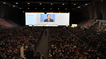 Daniel Vasella, CEO of Swiss pharmaceutical group Novartis, is projected on a screen as he speaks during the general assembly of Novartis in Basel, Switzerland, Tuesday, Feb. 24, 2009. (AP Photo/Keystone, Georgios Kefalas)