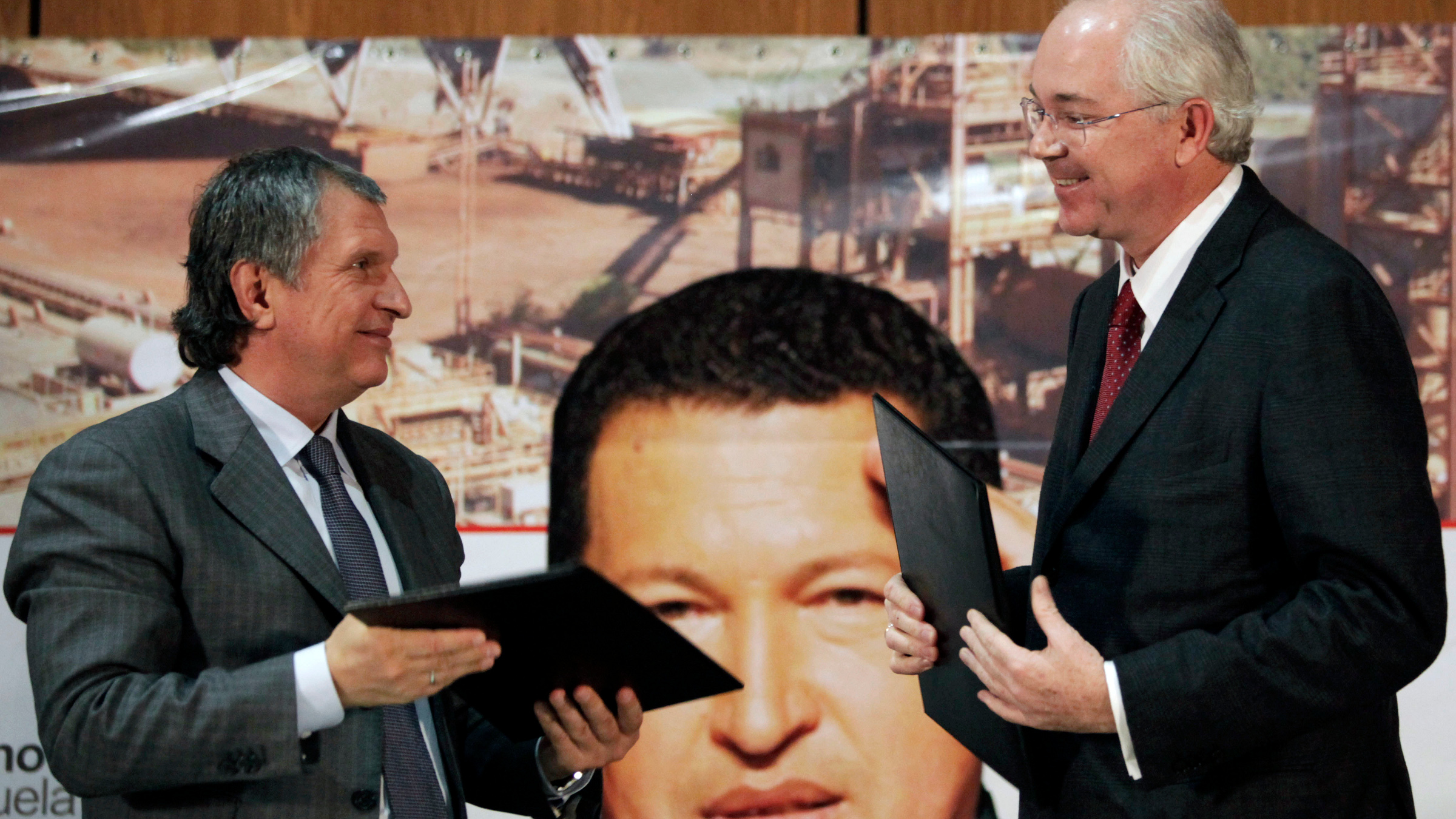 Venezuela's Oil Minister Rafael Ramirez, right, and Igor Sechin, chief executive of Russian energy company Rosneft, smile at each other after a signing ceremony in Caracas, Venezuela, Tuesday, Jan. 29, 2013.