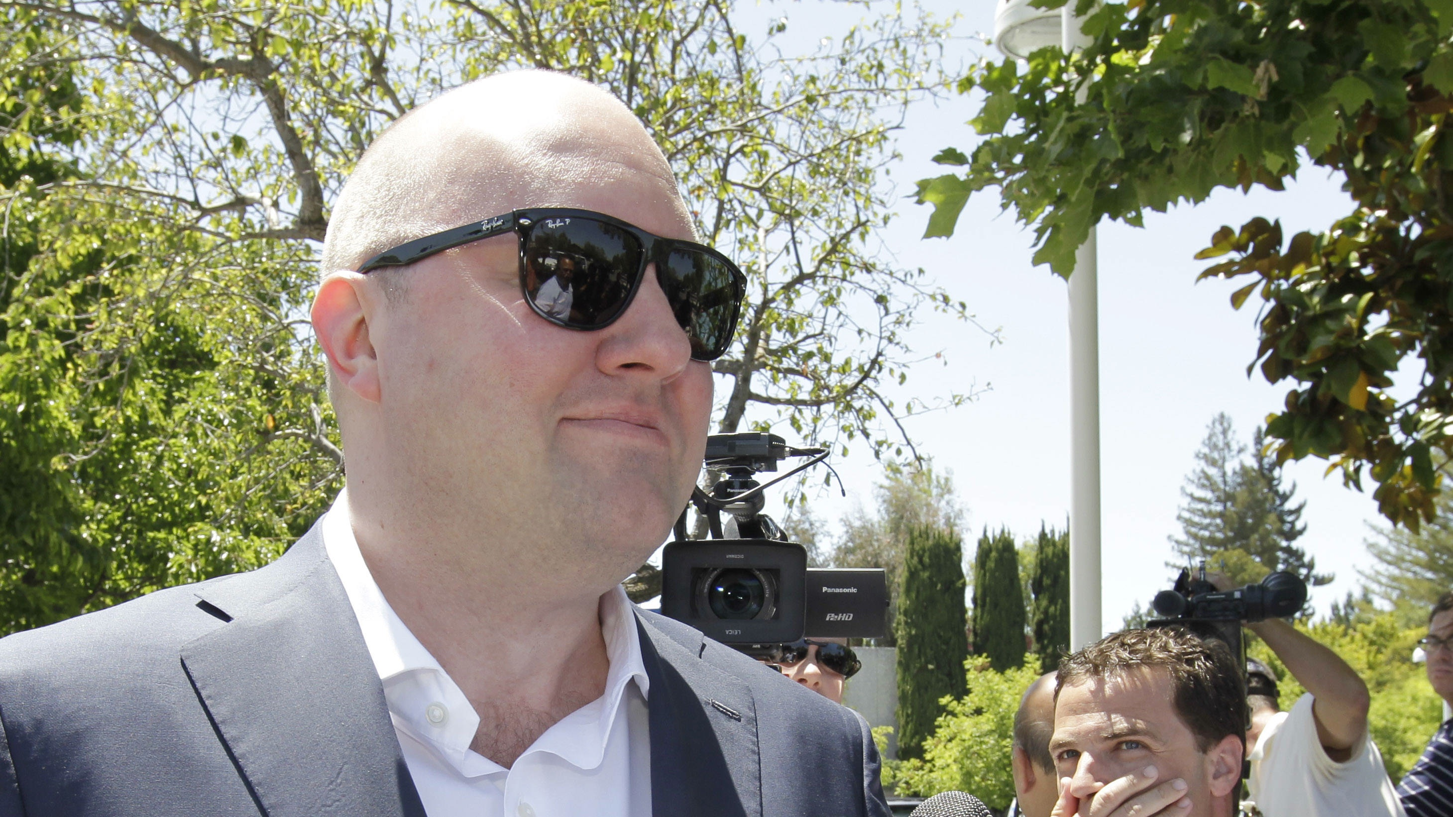 Facebook board member Marc Andreessen, who also co-founded Netscape, leaves a hotel in Palo Alto, Calif., Friday, May 11, 2012 from an investors meeting about Facebook's IPO. CEO Mark Zuckerberg and other executives spoke to prospective investors at the hotel luncheon on Friday. The event was the last of the bigger roadshows Facebook Inc. is holding ahead of its initial public offering expected late next week. (AP Photo/Paul Sakuma)