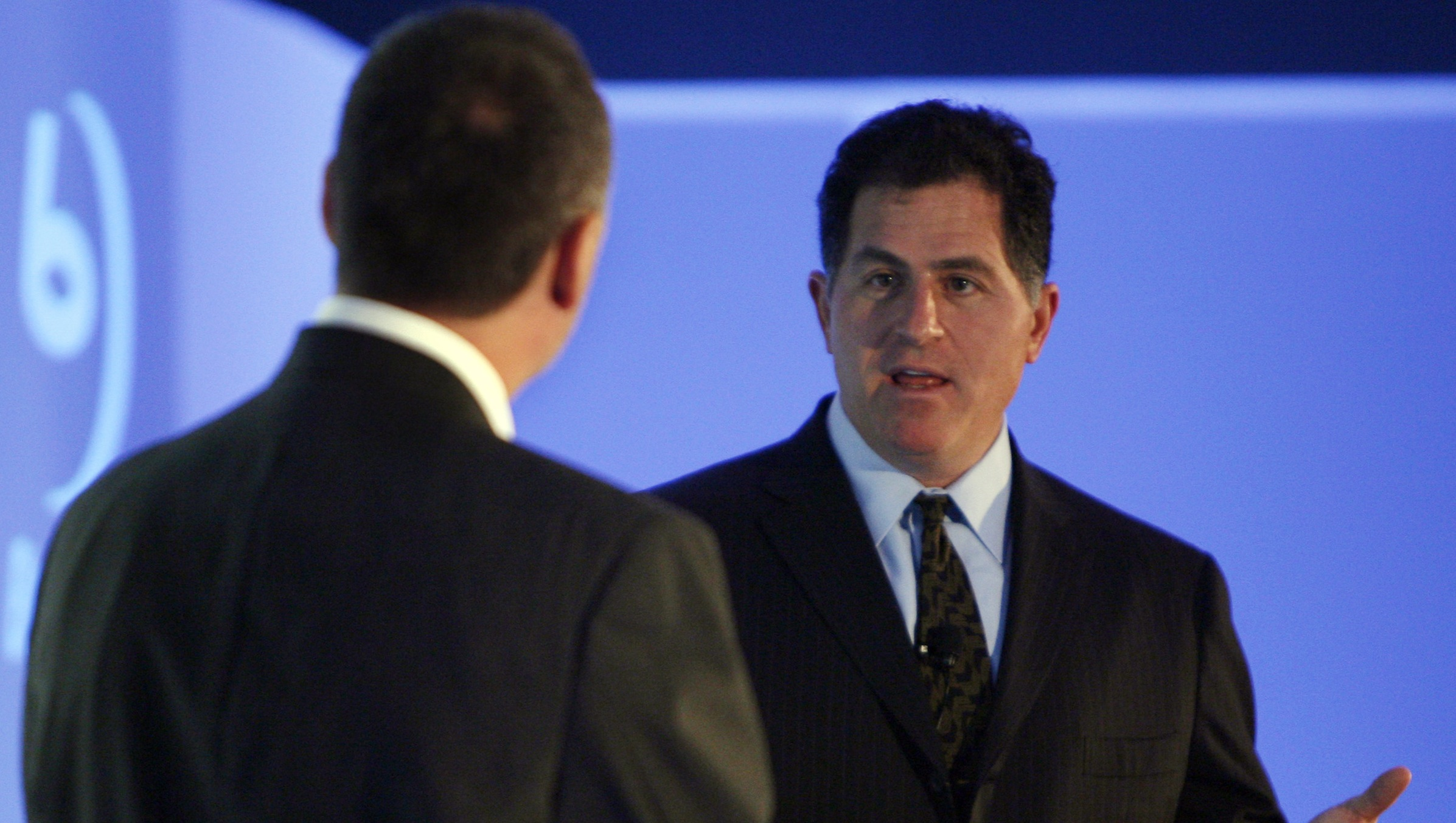 CEO of Dell Michael Dell, right, speaks to his Chief Technology Officer Kevin Kettler at a conference Tuesday, Sept 12, 2006 in New York.  (AP Photo/Seth Wenig)