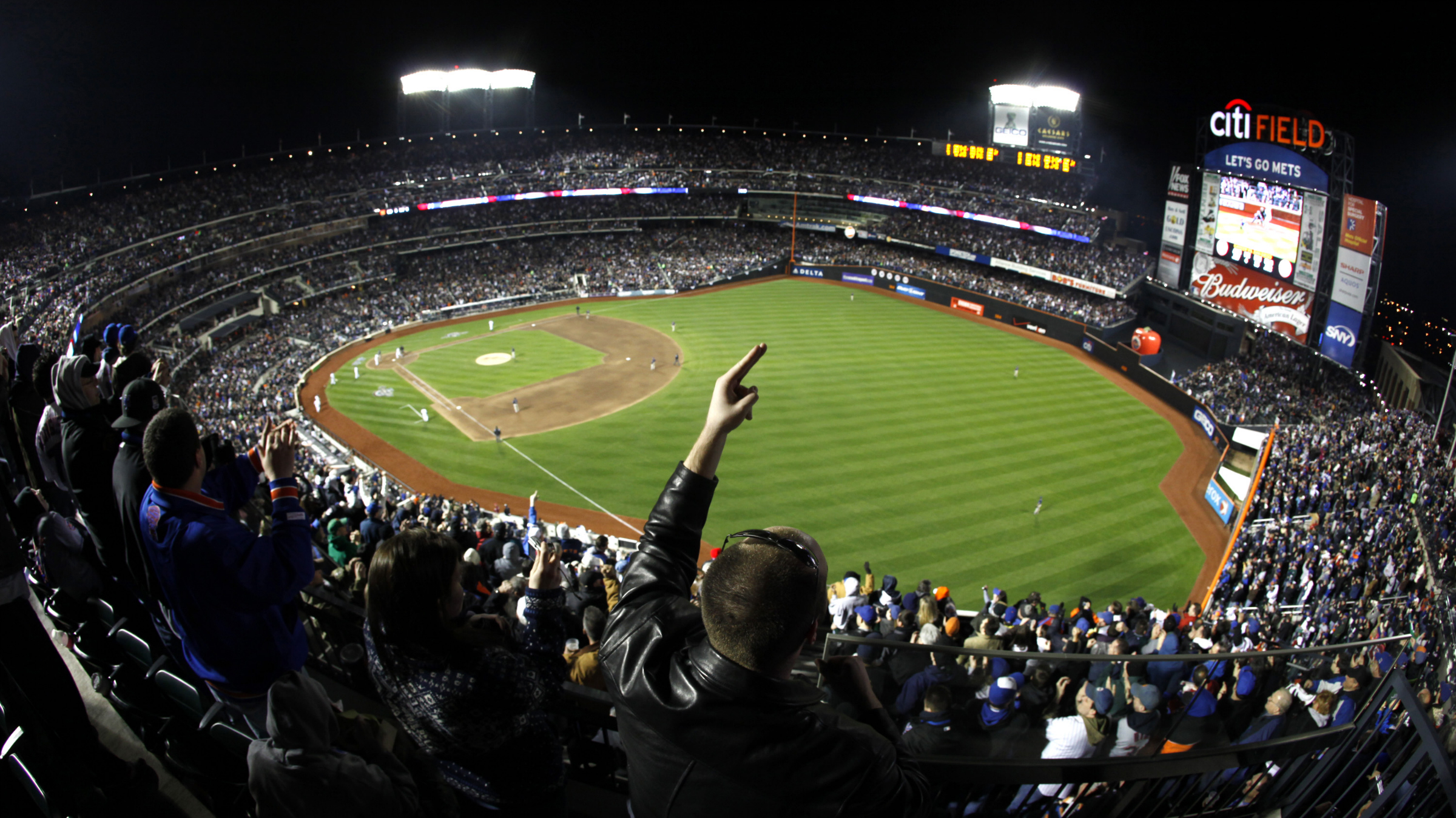 New York Mets fan Michael Zinn of tyhe Staten Island borough of New York cheers David Wright's fifth-inning three-run home run against the San Diego Padres in the first regular season baseball game at Citi Field, on Monday, April 13, 2009, in New York. (AP Photo/Julie Jacobson)