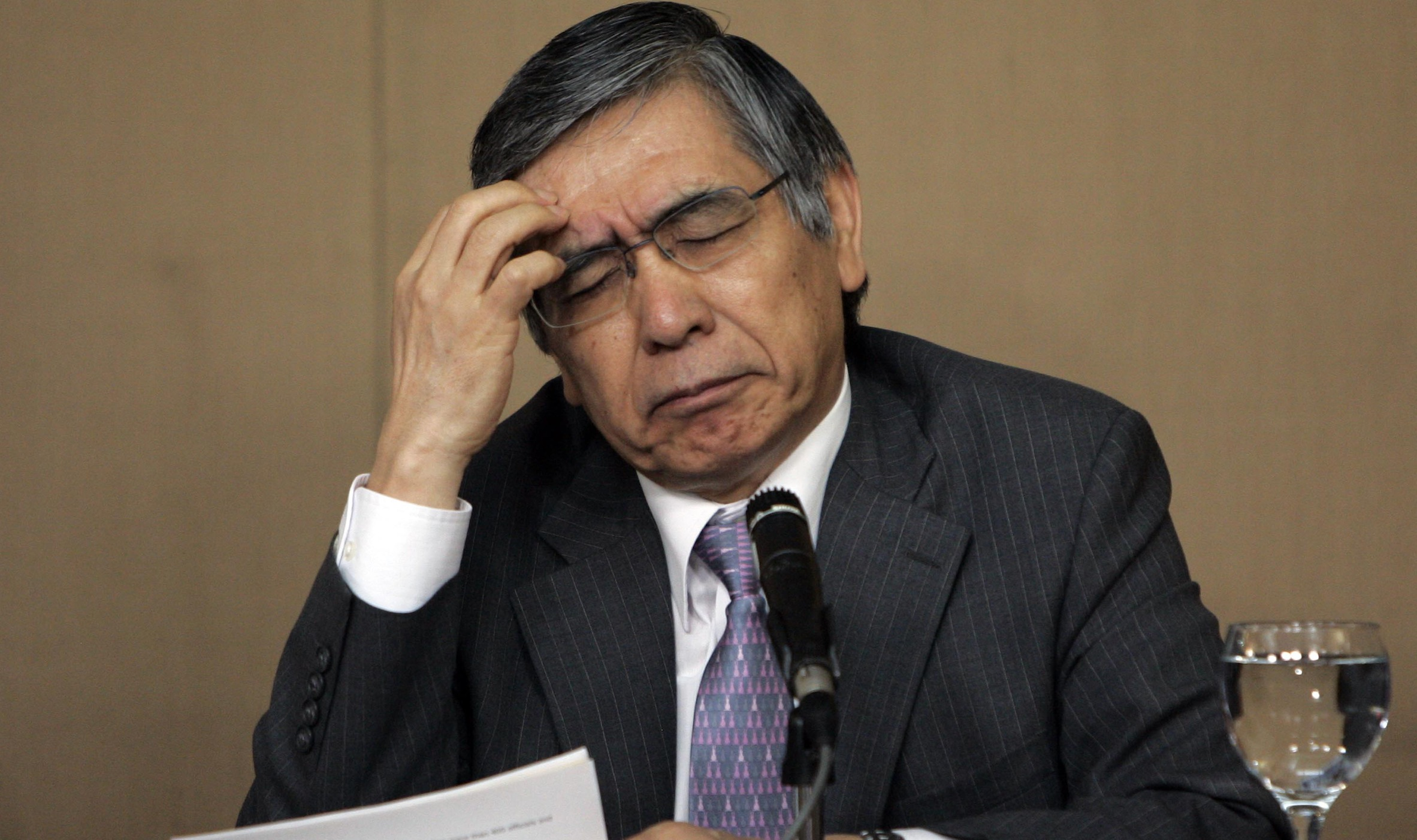 Asian Development Bank of the Philippines President Haruhiko Kuroda reacts during a press conference at the Malacanang palace Thursday, March 1, 2012 in Manila, Philippines. Kuroda commended the adminitration of President Benigno Aquino III for its focus on government reforms and announced the holding of the 45th annual meeting of the Board of Governors of ADB in the country. (AP Photo/Pat Roque)