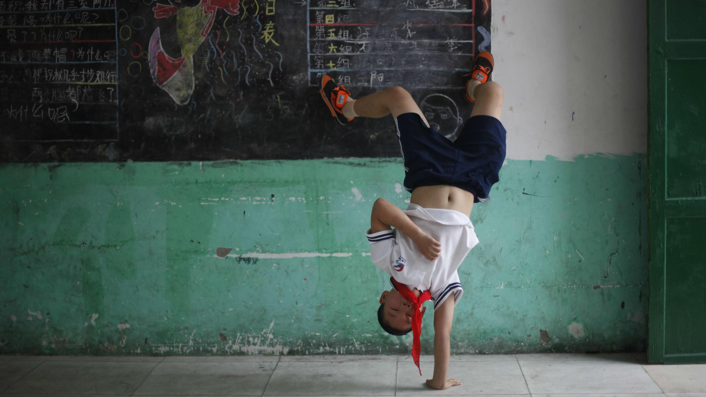 Chinese child doing a cartwheel