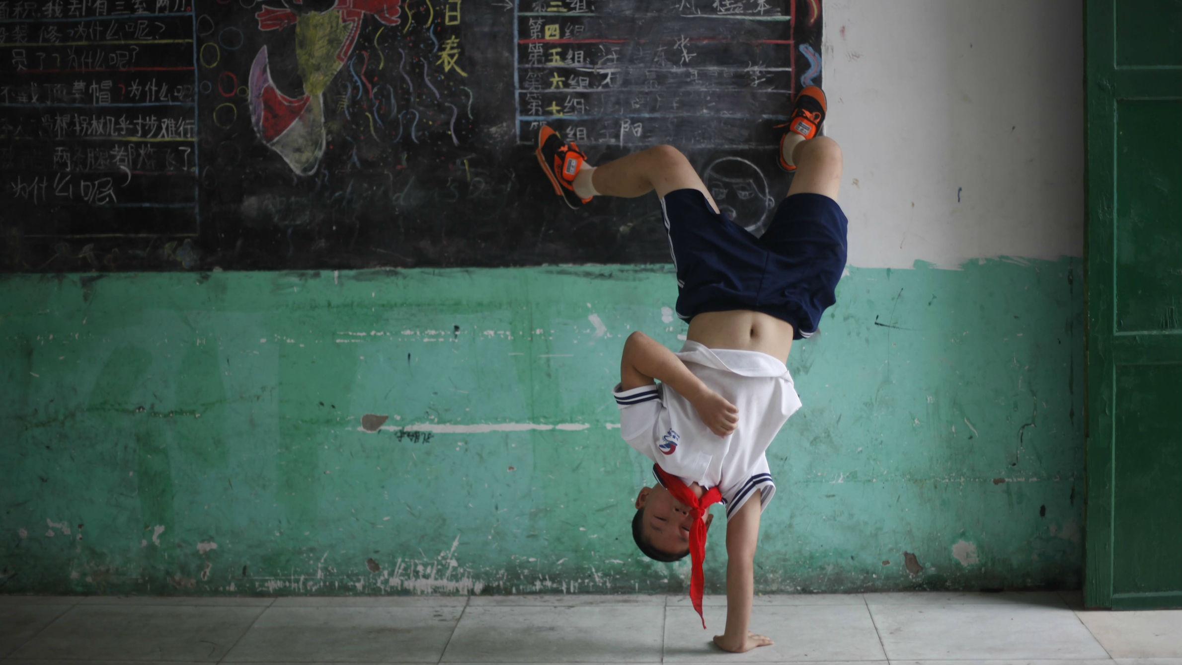 Chinese child doing a cartwheel