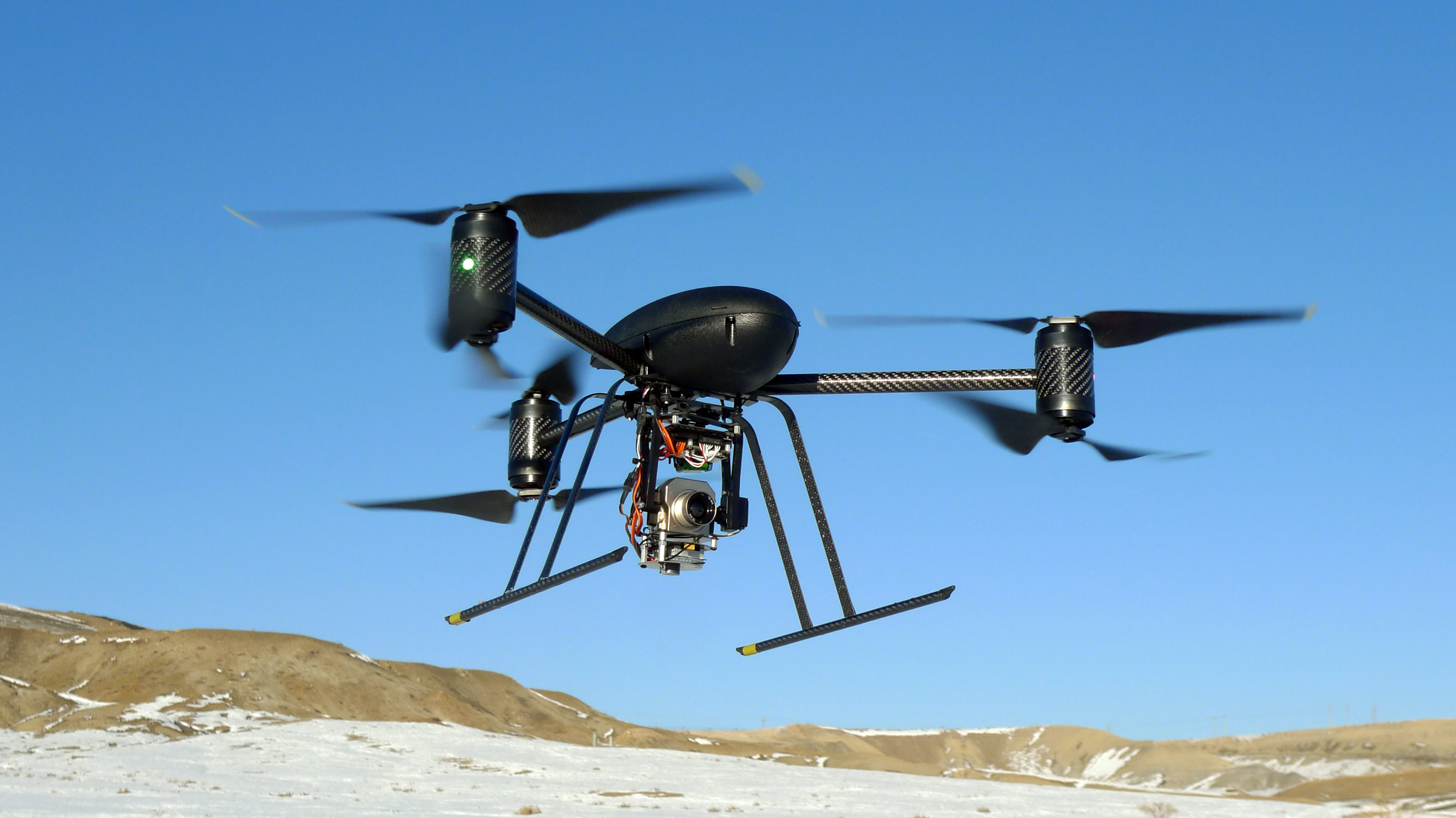 In this Jan. 8, 2009, photo provided by the Mesa County Sheriff's Department, a small Draganflyer X6 drone is photographed during a test flight in Mesa County, Colo., with a Forward Looking Infared payload.