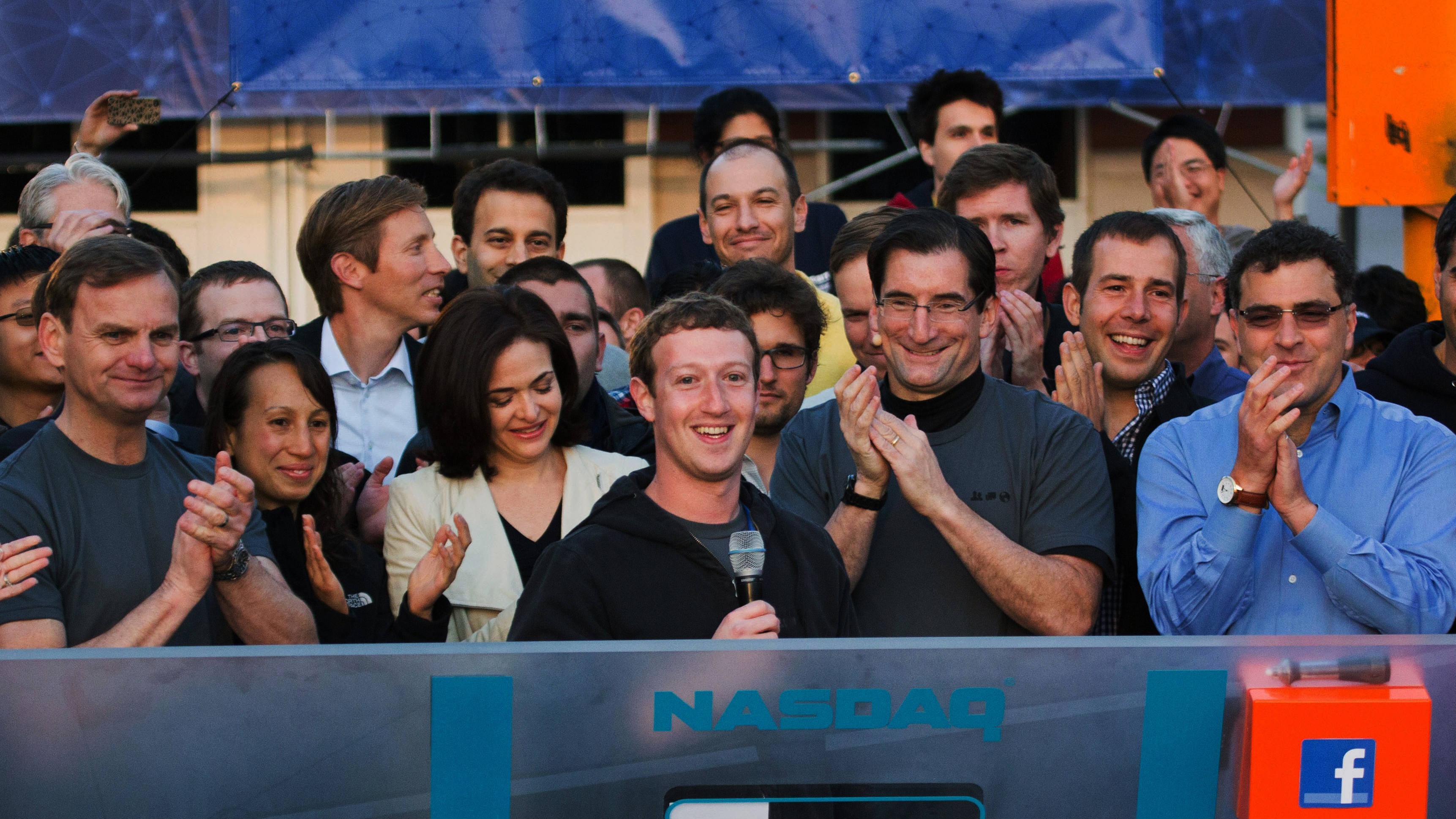 In this May 18, 2012 file photo provided by Facebook, Facebook founder, Chairman and CEO Mark Zuckerberg, center, rings the Nasdaq opening bell from Facebook headquarters in Menlo Park, Calif. Years of anticipation led to Facebook's initial public offering of stock in 2012, the hottest Internet IPO since Google's in 2004. Many of the 1 billion-plus users of the world's largest online social network craved a chance to buy in early. On the eve of its first trading day, Facebook's market value was $105 billion, yet the IPO bombed. (AP Photo/Nasdaq via Facebook, Zef Nikolla, File)