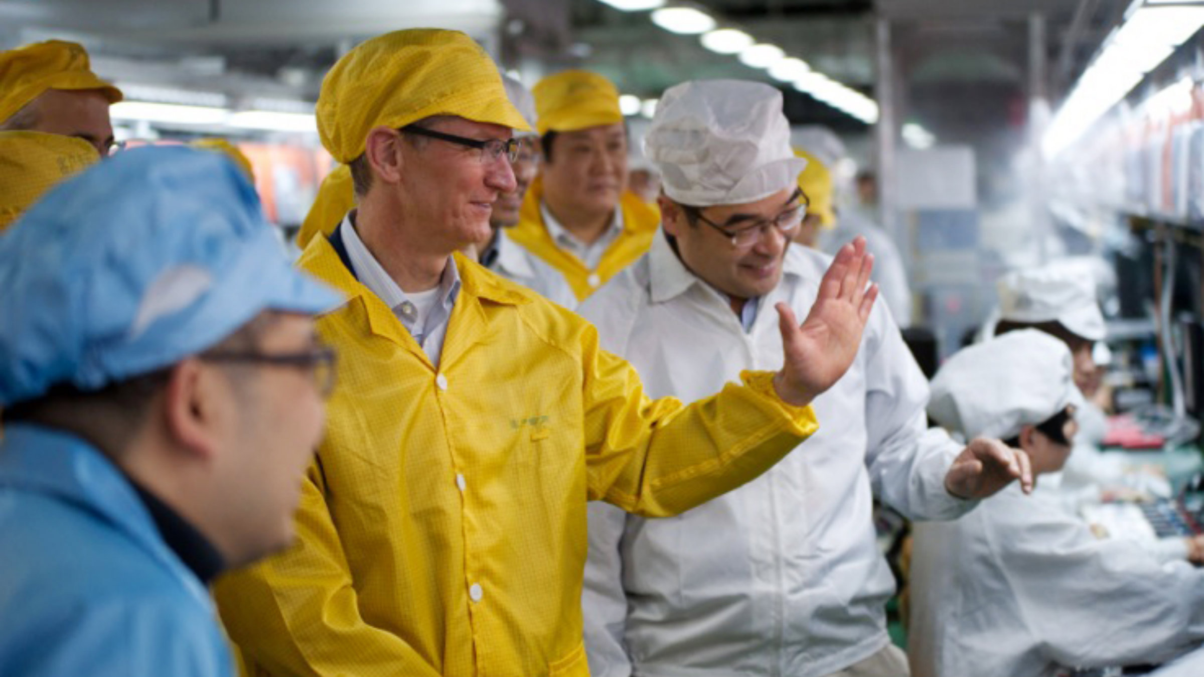 Tim Cook watches the (subsidized?) iPhone sausages getting made.